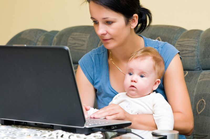 http://www.dreamstime.com/stock-image-mother-baby-laptop-image15789891