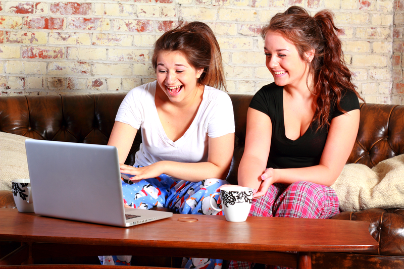 http://www.dreamstime.com/royalty-free-stock-photo-teens-computer-two-brunette-teenage-girls-sitting-couch-their-pajamas-laughing-looking-image32820575