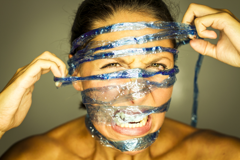 http://www.dreamstime.com/royalty-free-stock-photos-captured-young-woman-blue-string-image33225638