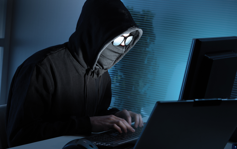 http://www.dreamstime.com/royalty-free-stock-photo-hacker-stealing-data-computer-young-male-thief-image33823335