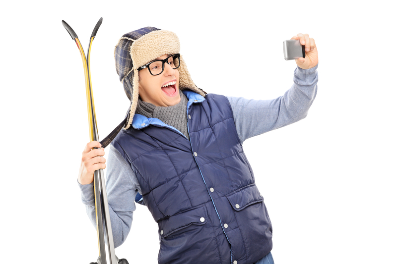 http://www.dreamstime.com/stock-image-man-winter-clothes-taking-selfie-skis-isolated-white-background-image39419591