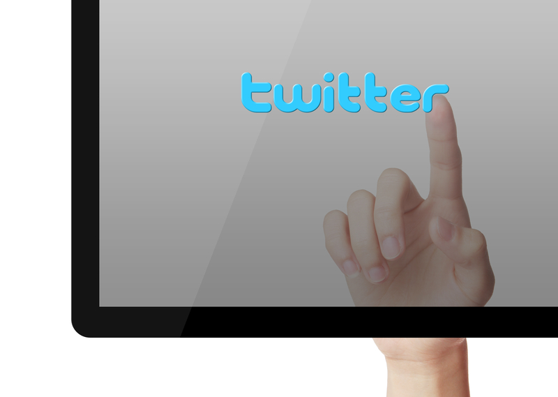 http://www.dreamstime.com/royalty-free-stock-photography-twitter-concept-hand-press-button-blue-background-image41174297