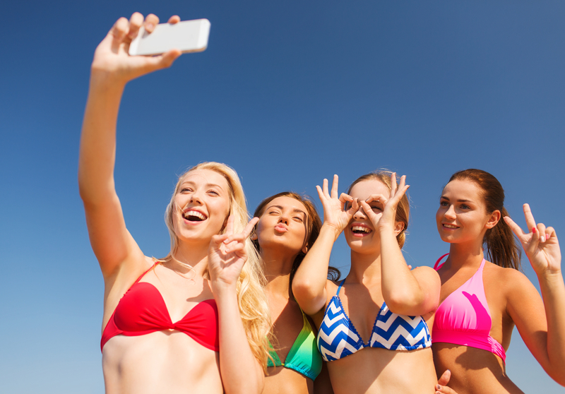 http://www.dreamstime.com/royalty-free-stock-images-group-smiling-women-making-selfie-beach-summer-vacation-holidays-travel-technology-people-concept-young-smartphone-image43522949