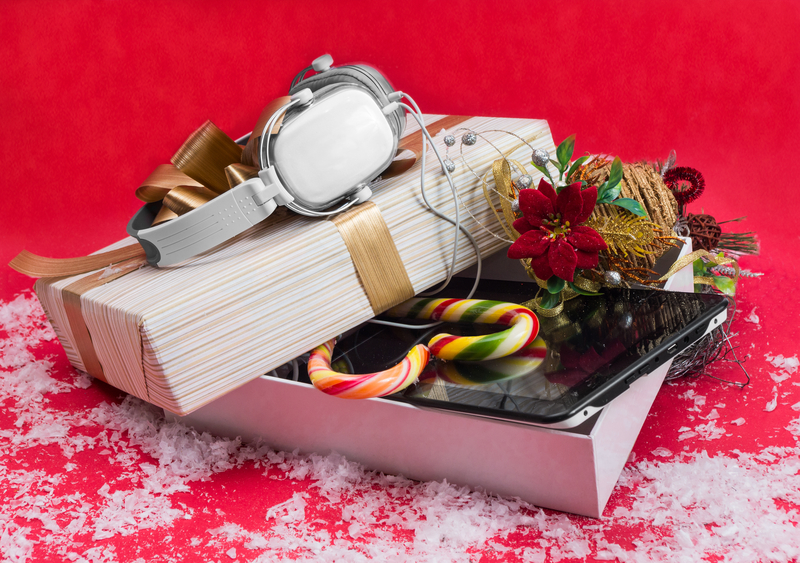 http://www.dreamstime.com/stock-photography-tablet-headphones-best-christmas-gift-decorative-box-red-background-image46902152