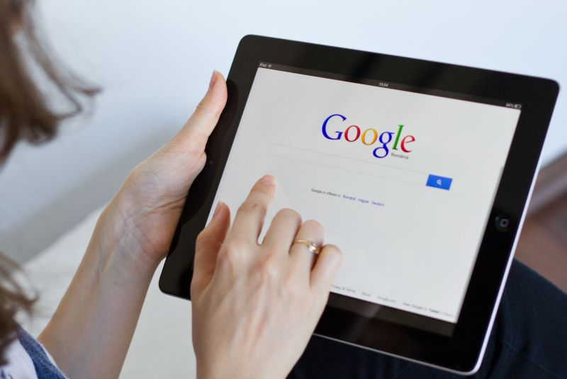 http://www.dreamstime.com/royalty-free-stock-photos-google-woman-performs-digital-tablet-image33653338